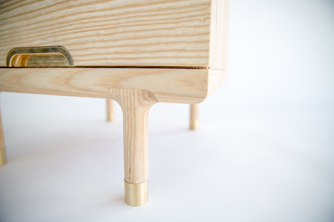 simple side table with brass foot detail